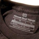 Almost Real Things ART Club Pocket Tee Shirt in Black, Tag Detail